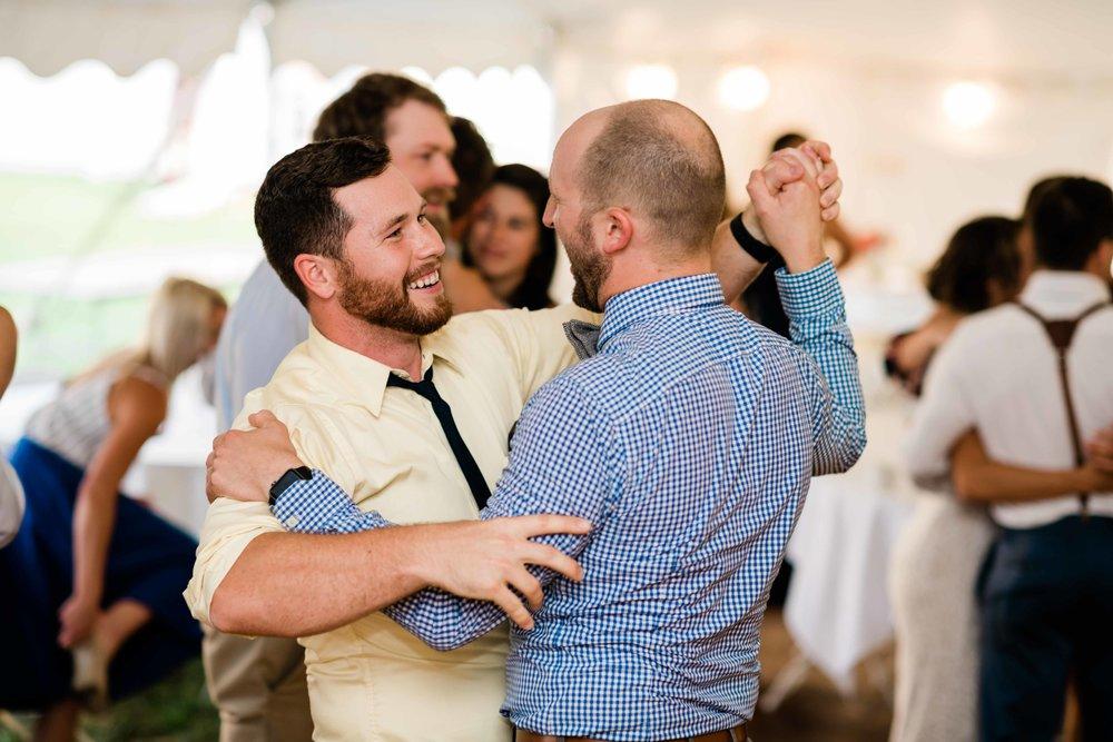 Wedding guests happily dancing