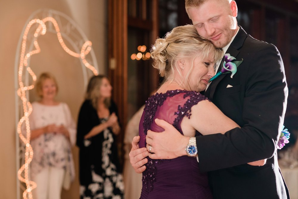 Mother of groom tearing up as she dances with her son
