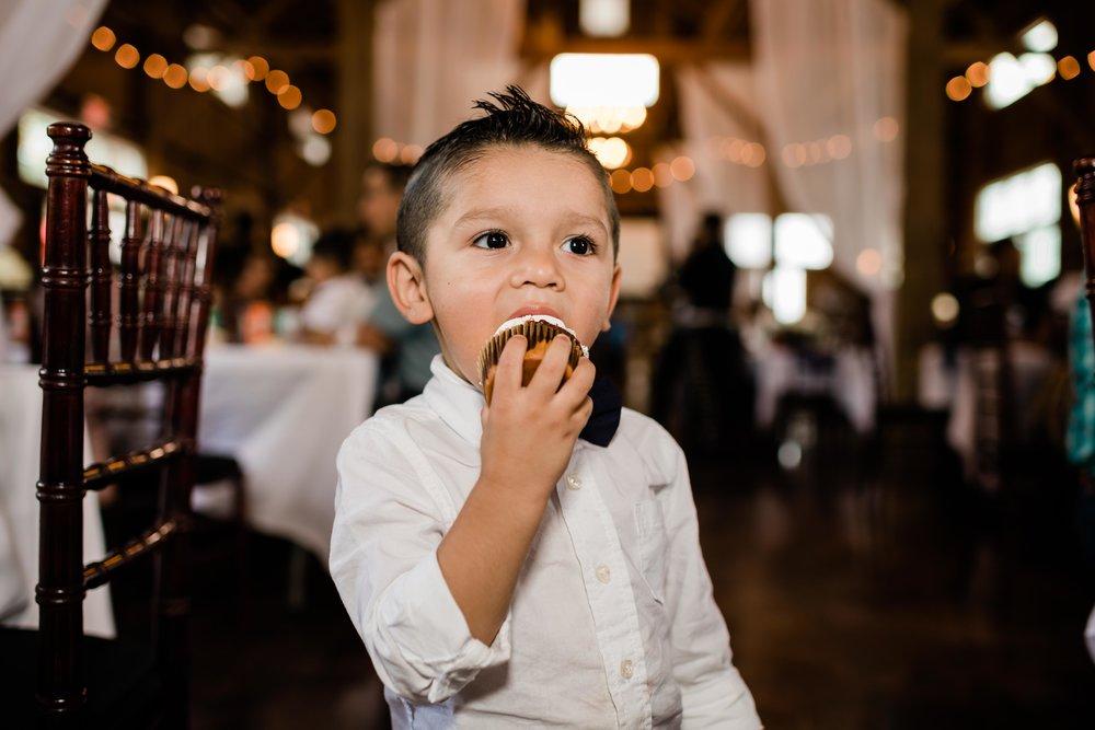 Child eating wedding cupcake