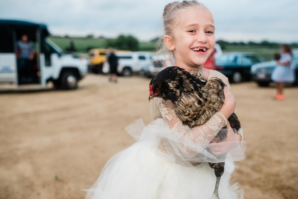 Flower girl holding a rooster