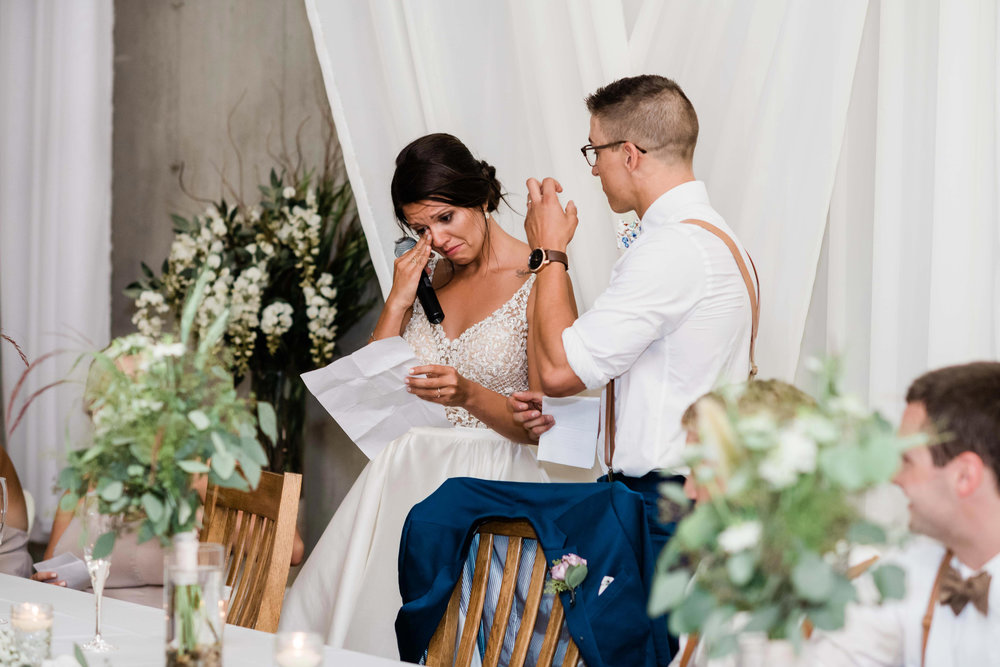 Bride wipes away tears as she gives a thank you speech