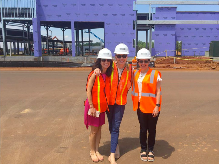 Site selection analysis to help you select the perfect location for your studio   (seen here: Noelle on a new construction site visit)