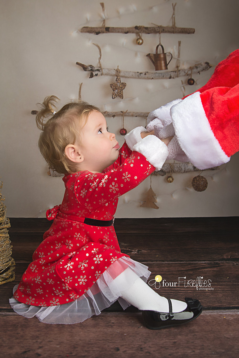 St-Louis-photographer-holiday-mini-sessions-2017-girl-in-red-dress-holding-santas-hands.jpg