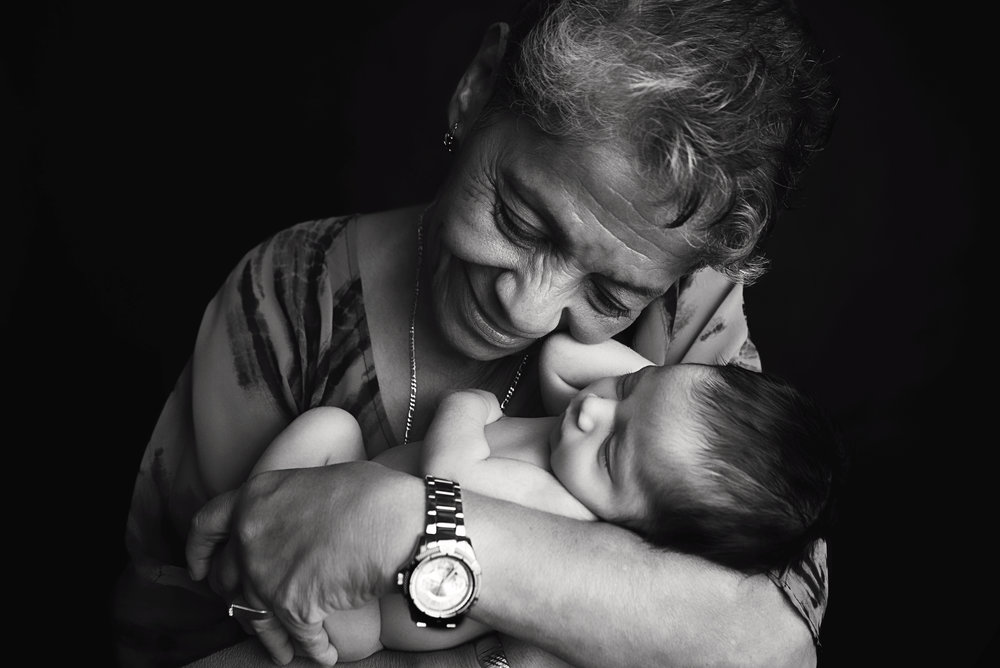 st-louis-newborn-photographer-black-and-white-of-grandma-cuddling-with-newbonr-boy.jpg
