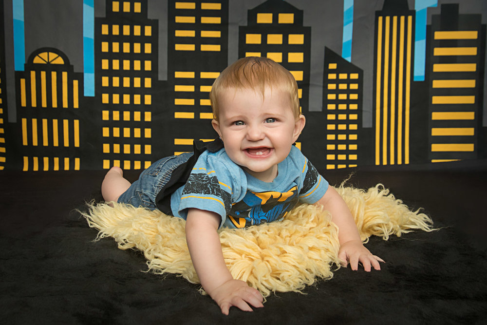 st-louis-baby-photographer-6-month-milestone-session-batman-shirt-and-comic-scene-background.jpg