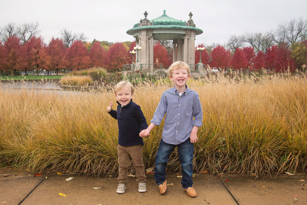 st-louis-childrens-photographer-brother-laughing-at-muny-forest-park-in-the-fall.jpg
