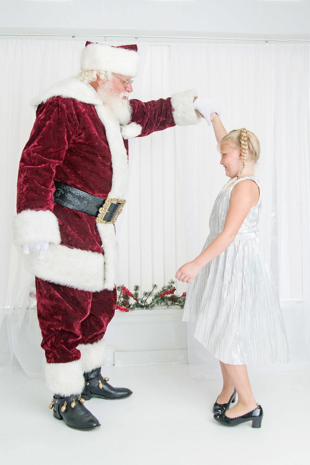 st-louis-photography-studio-sessions-with-santa-2018-santa-dancing-with-older-child.jpg