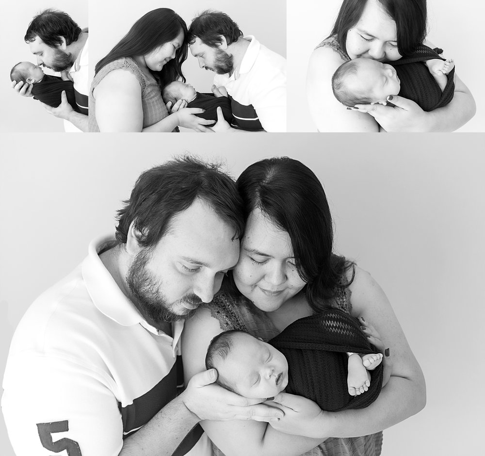 st-louis-newborn-photographer-baby-boy-with-mom-and-dad-in-black-and-white.jpg