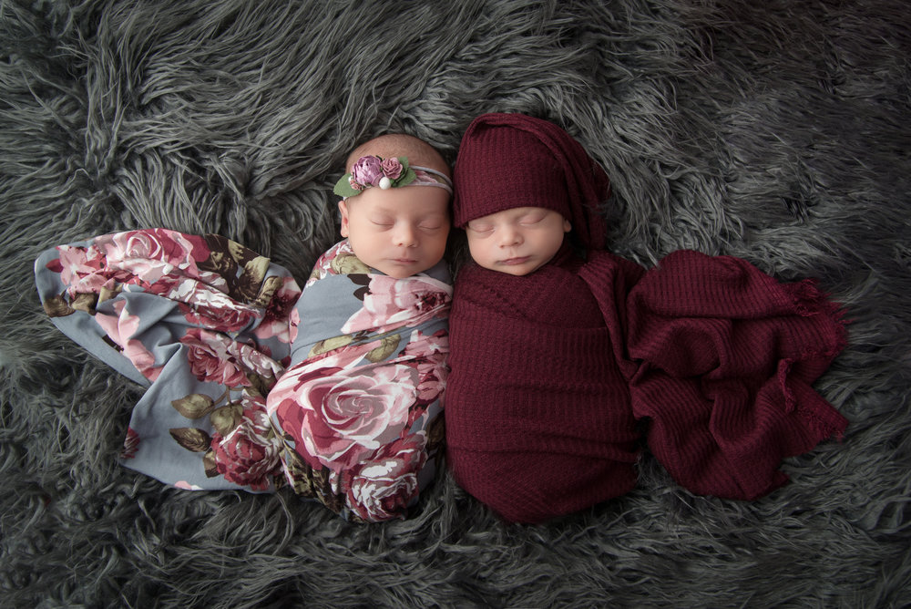 st-louis-newborn-photographer-boy-and-girl-twins-on-gray-fur-with-floral-wrap.jpg