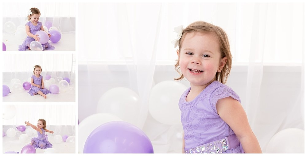 st-louis-birthday-photographer-three-year-old-girl-in-white-room-with-purple-balloons.jpg