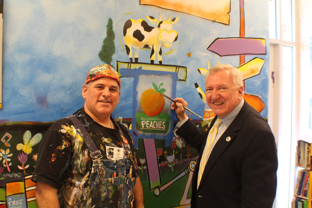 Mural artist  John Donato  and Mayor Gee Williams