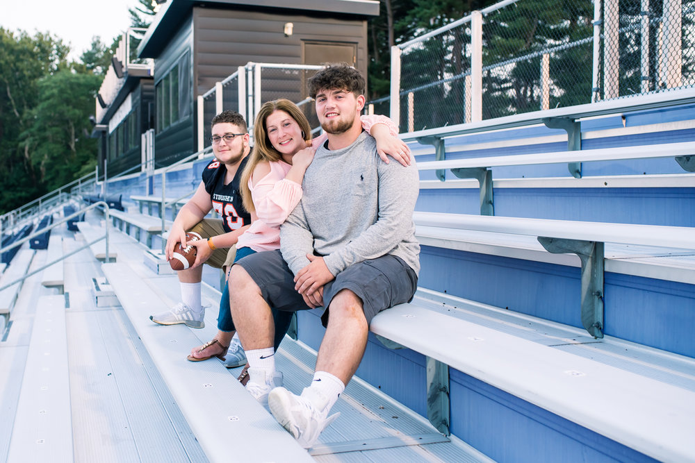 Stoghton High School Senior Guy at Stonehill College Football Field Bleachers with his buddy and mom (10 of 1).jpg