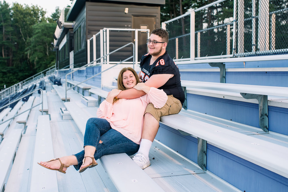 Stoghton High School Senior Guy with his mom at Stonehill College Football Field Bleachers (9 of 1).jpg