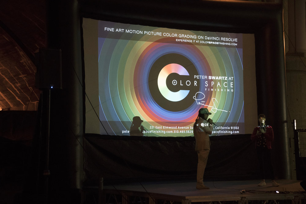 Jacques and Emily Ann on stage with Colorspace Finishing logo.jpeg