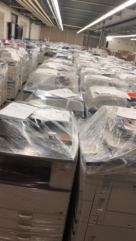 Ricoh copiers wrapped in plastic.jpg