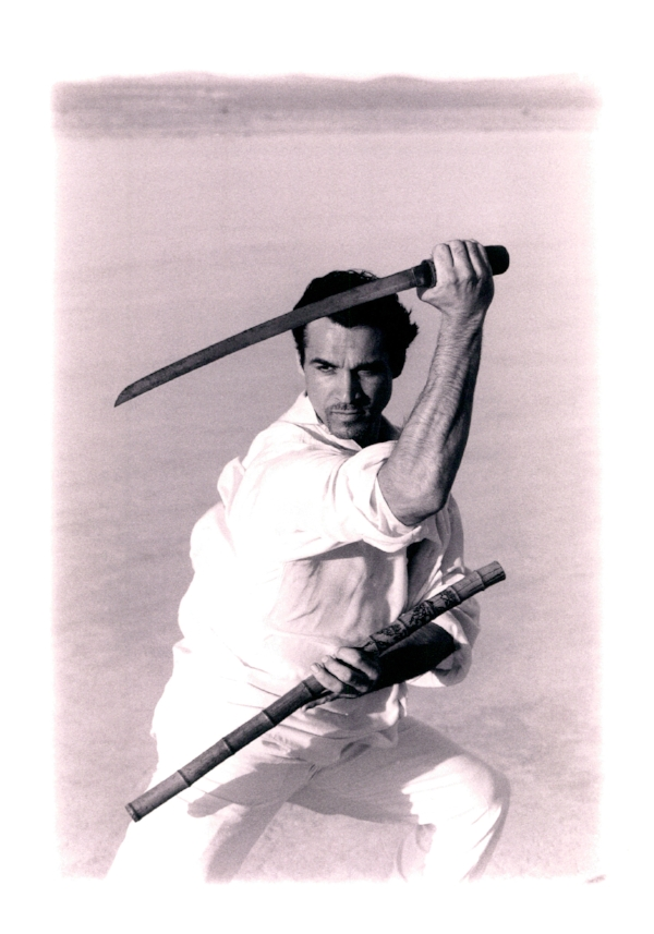 About Adrian Paul - Adrian Paul is an actor renowned for his lead role, as Duncan Macleod, in the action series Highlander. The show spanned 6 seasons, 117 episodes and ran in over 90 countries world wide. As well as starring in numerous action films, including two Highlander Films, he has also choreographed numerous sword fights and action sequences for both television and film during his 30 year entertainment career. During that time he also directed and produced TV and Film along with founding his own charity The PEACE Fund. (Protect, Educate, Aid Children Everywhere). The PEACE Fund has been in existence since 1997, helping improve the lives of children, in the US, Haiti, Thailand, Cambodia, Pakistan, Hungary and Romania. In June 2015, Adrian ran a Sword Experience workshop, to raise money for one of the children the PEACE Fund supported. The event went so well that Adrian decided to hold other similar events at venues across the US. At this once in a lifetime experience, Adrian will be hands on to pass on some of the knowledge he learned whilst working with world renowned action stars, stunt choreographers, and sword masters.