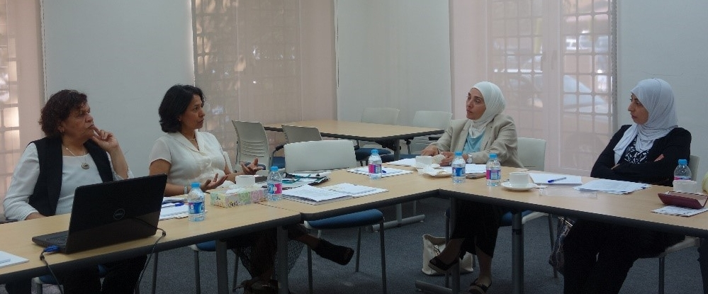 Drs. El-Bassel and Kaushal discuss research gaps during an ASPIRE visit to Amman in August 2016.