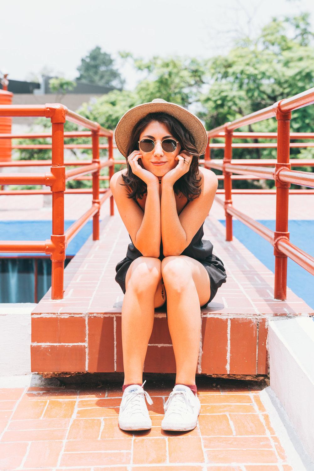 jess sitting on the love bridge
