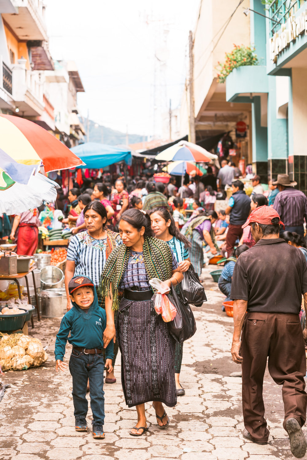 a sun and her mother at the market in Santiago at Lake atitlan