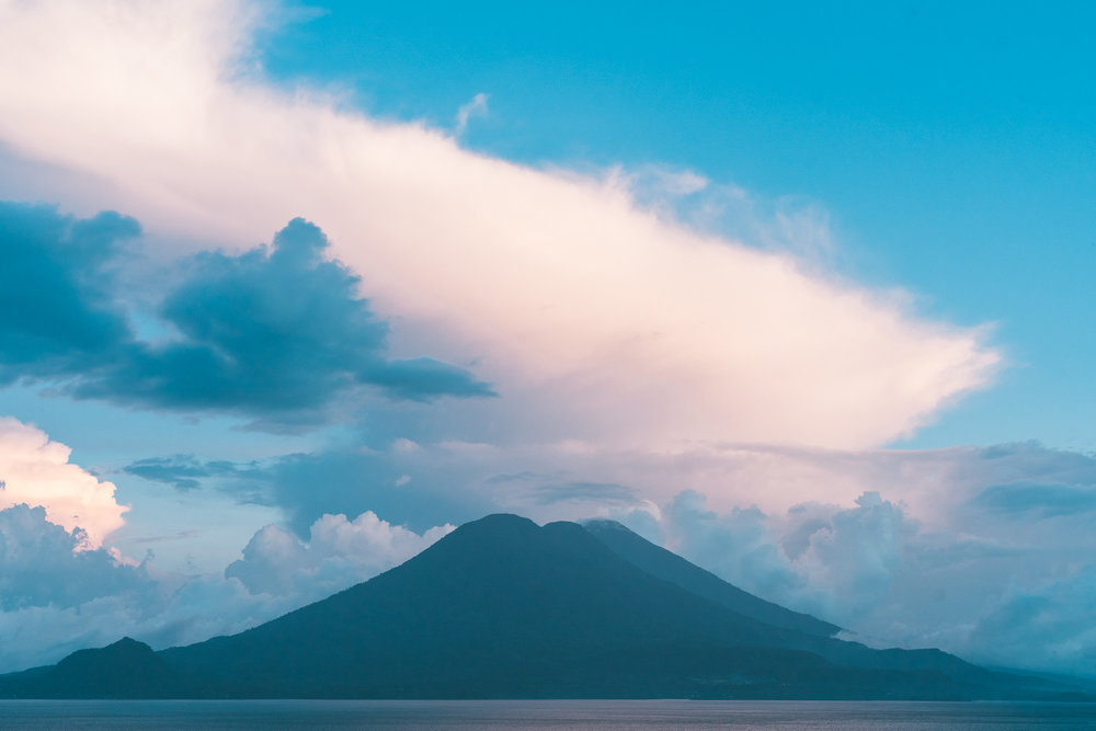volcanos with big clouds at lake atitlan