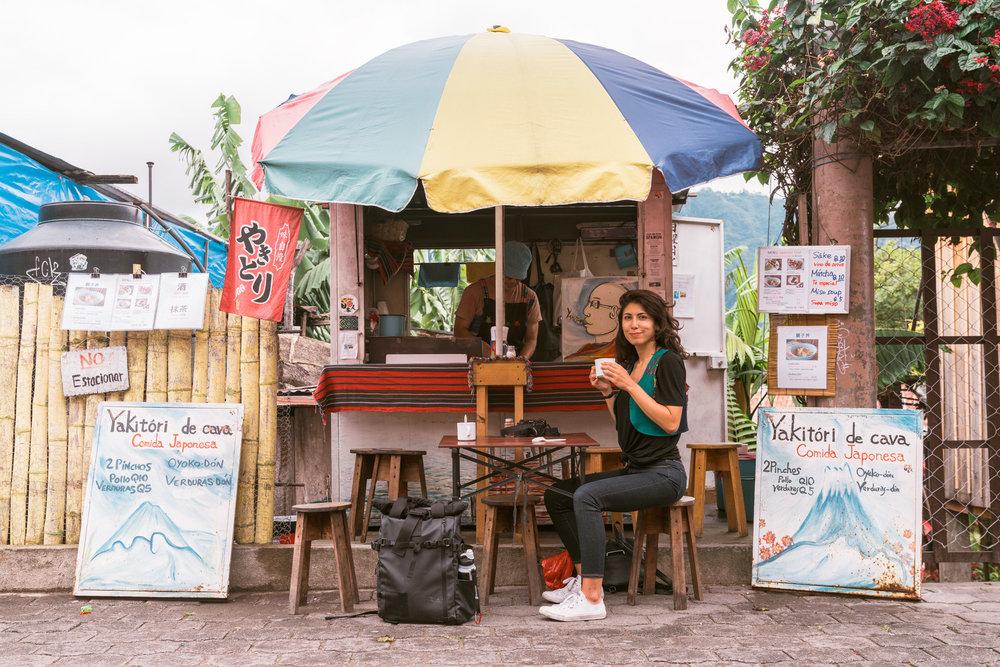 woman eating at yakatori de cava at lake atitlan