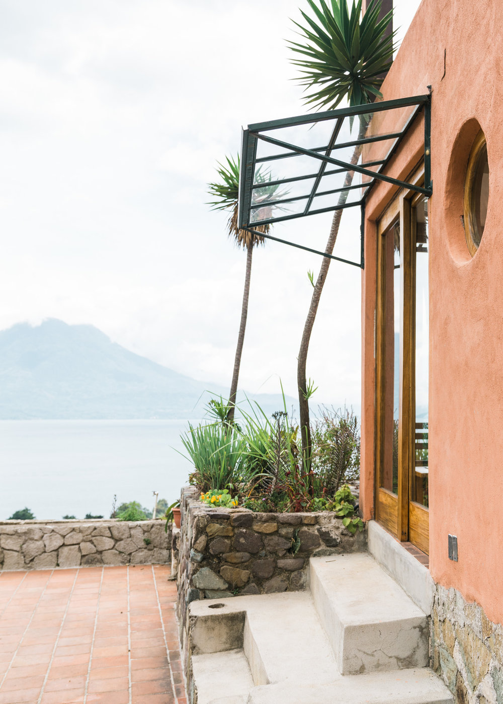 Door to the patio looking over the lake at Adobe Airbnb in Jaibalito at lake atitlan