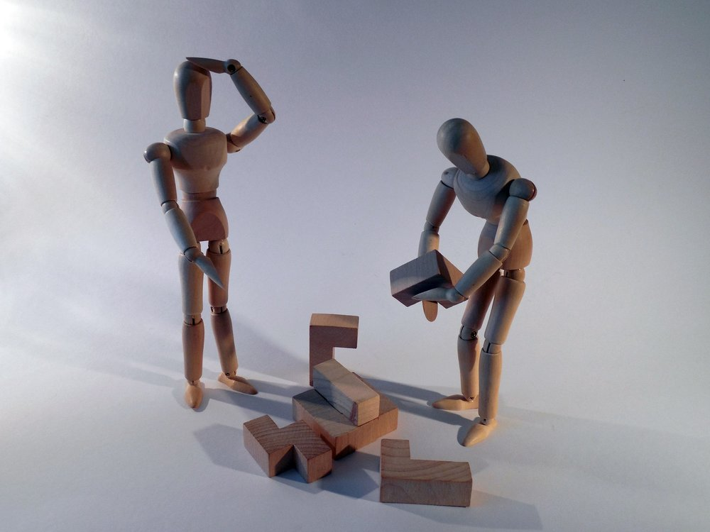 Wooden models building a puzzle