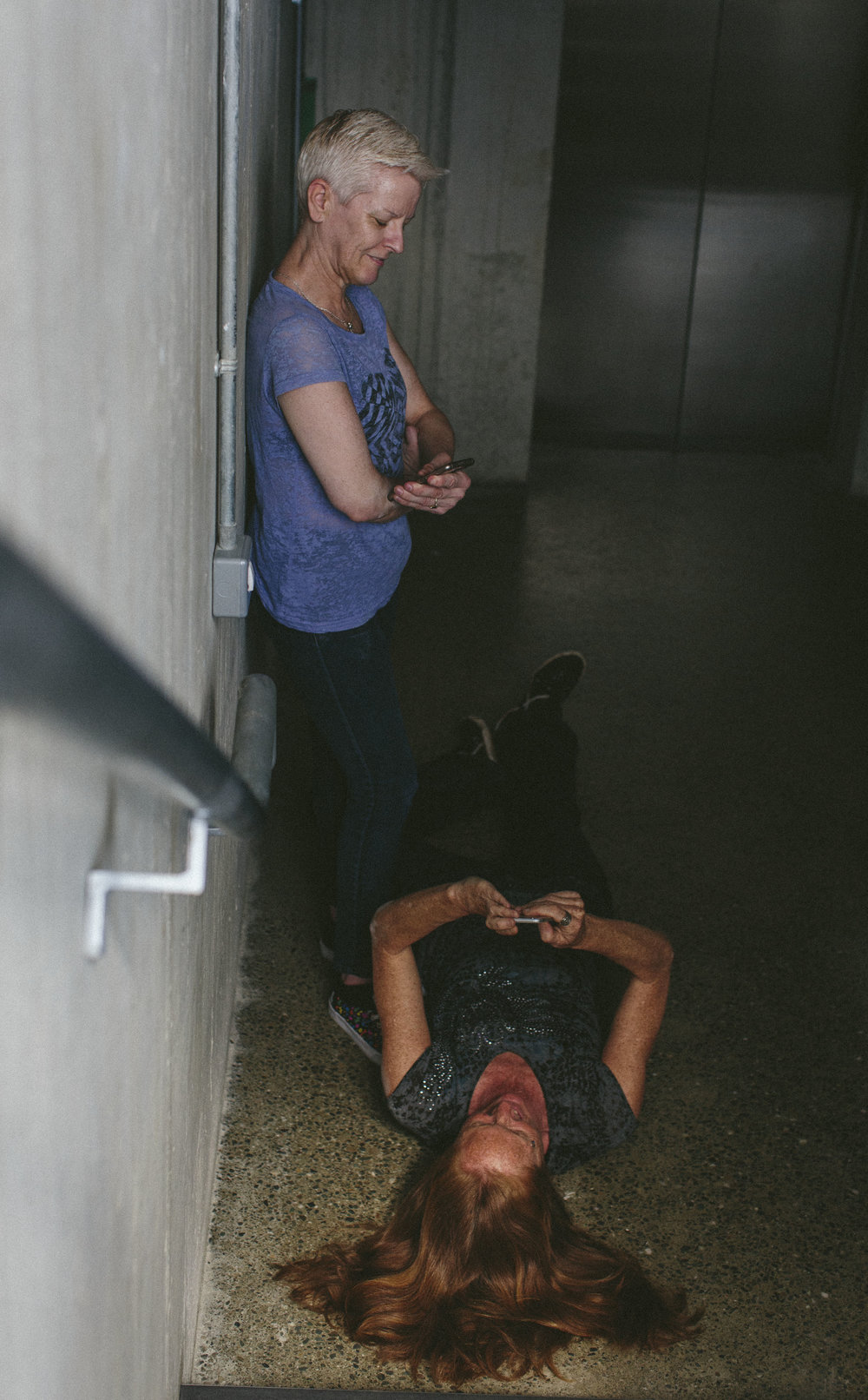 Tara Brandel lies on ground and Linda Fearon stands leaning against a wall (photo: Emma Jervis)