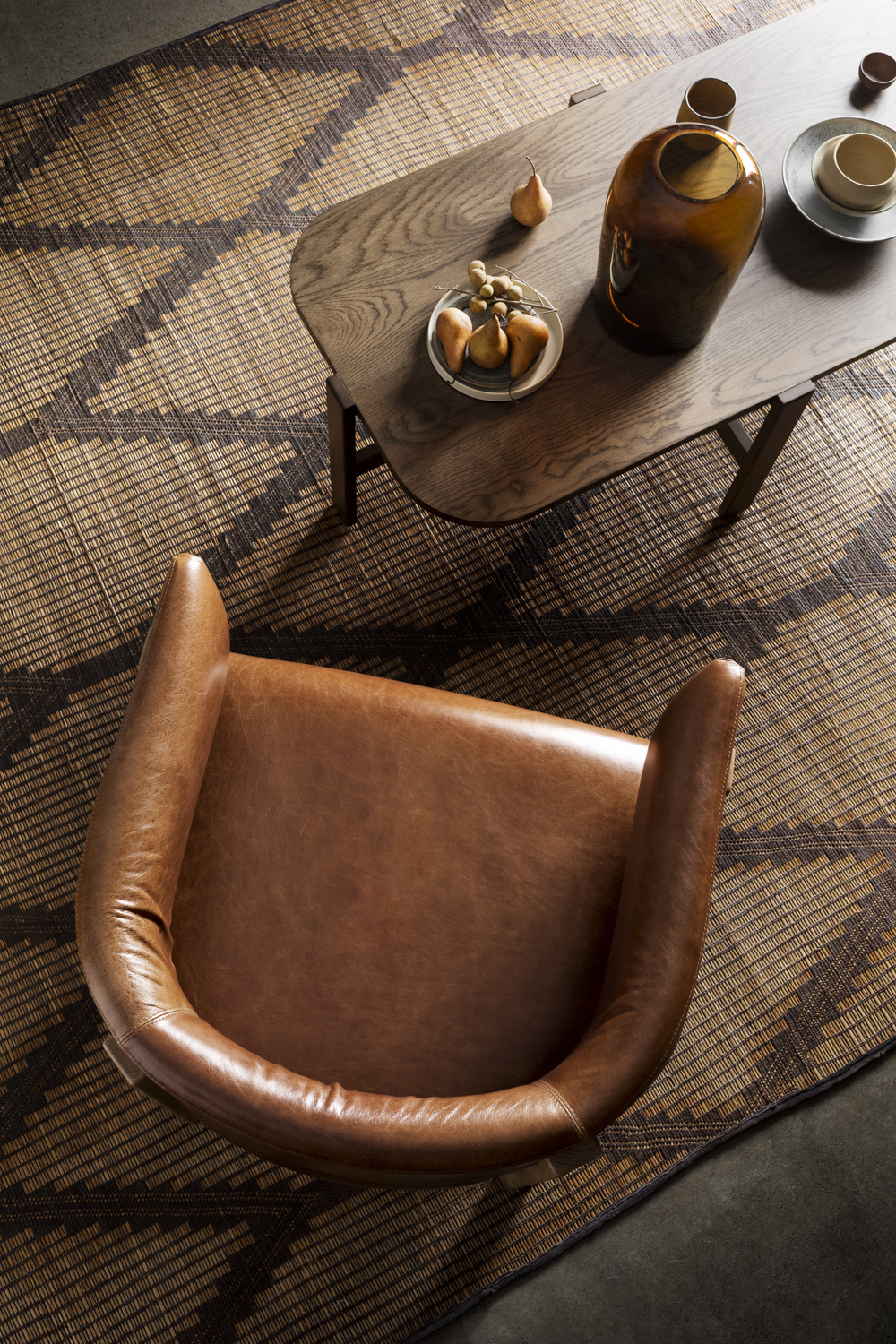 Bird's eye view of Flo armchair and coffee table. Showing off their beautiful curves.