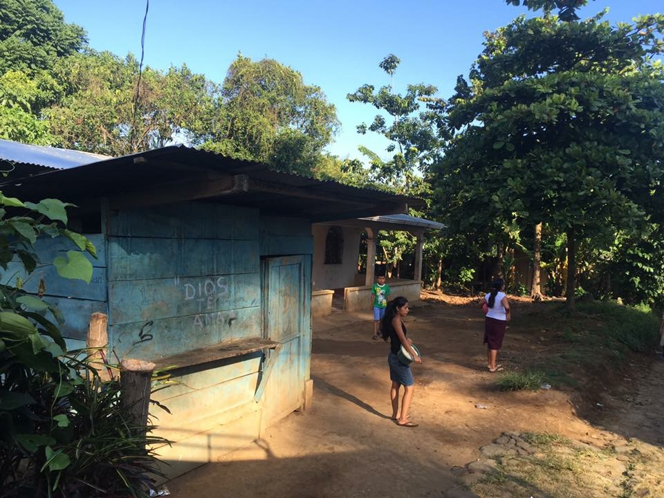 ' DIOS TE AMA ' // this was a building in Galvez where locals could grind corn into meal.