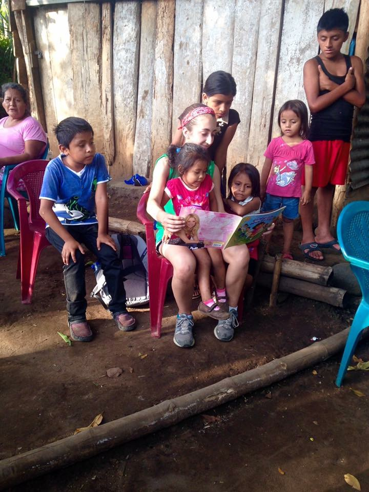 reading to a few kids in Villa Hermosa during stove training