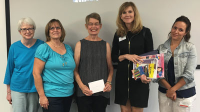 Representing Altrusa of Columbus at a ceremony recognizing the club were Treasurer Claudia Speakman, left, and President Jill DeVore, center, and Altrusa Foundation President Pat Fitzpatrick, second left.