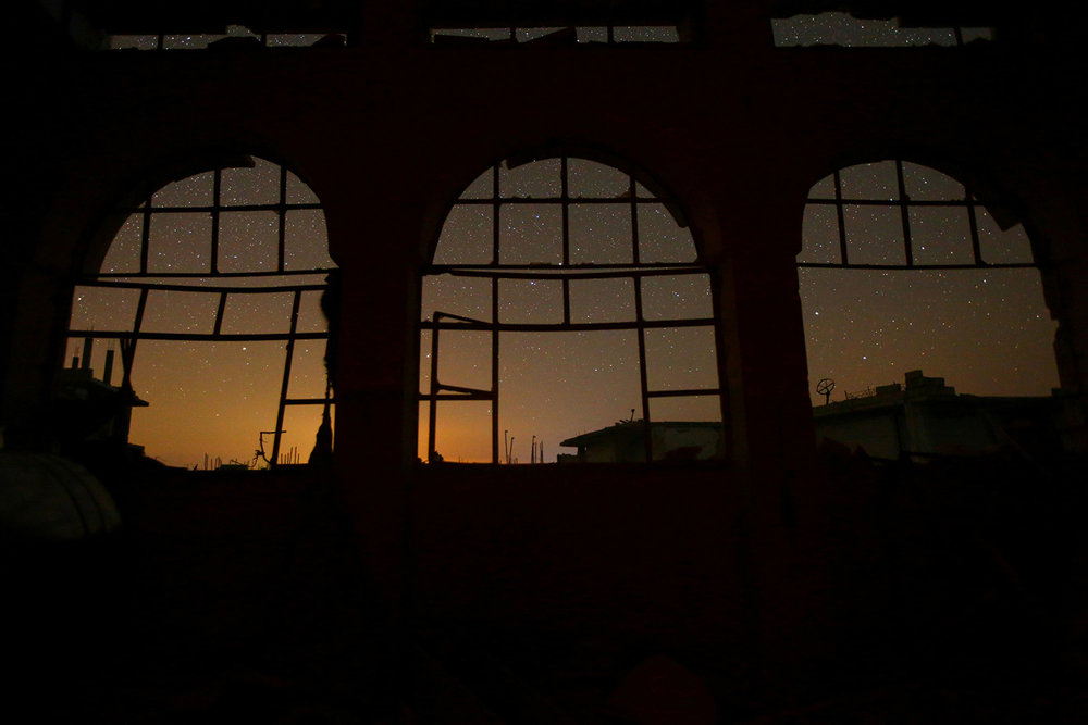 Sky is seen through damaged windows in the rebel-controlled town of Binnish in Idlib province, Syria, on September 7, 2016.