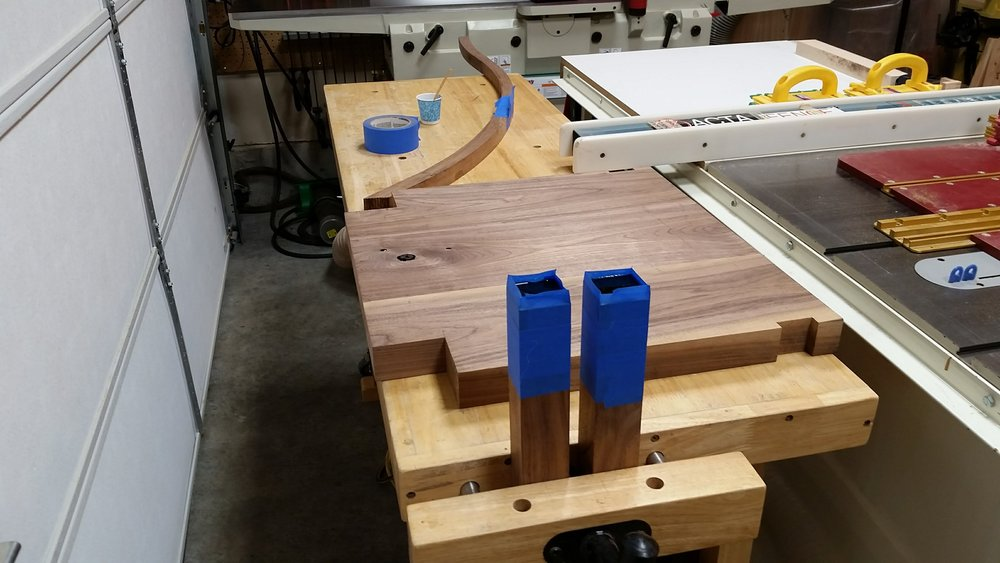 Front legs, seat slab, and runner with epoxy poured into the holes and voids.