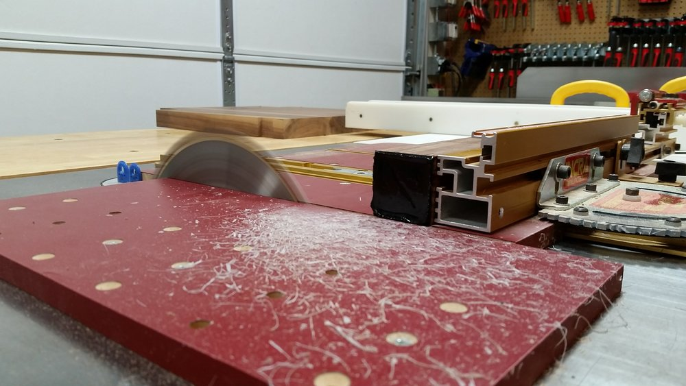 A quick trim of the excess epoxy on the cross-cut sled and the rear legs were ready for the next step.