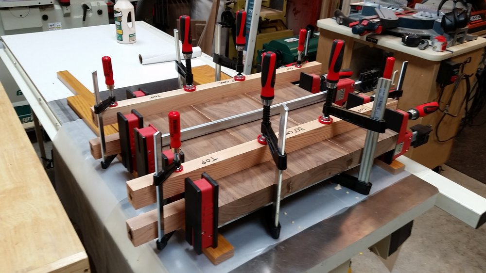 Seat boards clamped and aligned with the clamping cauls.