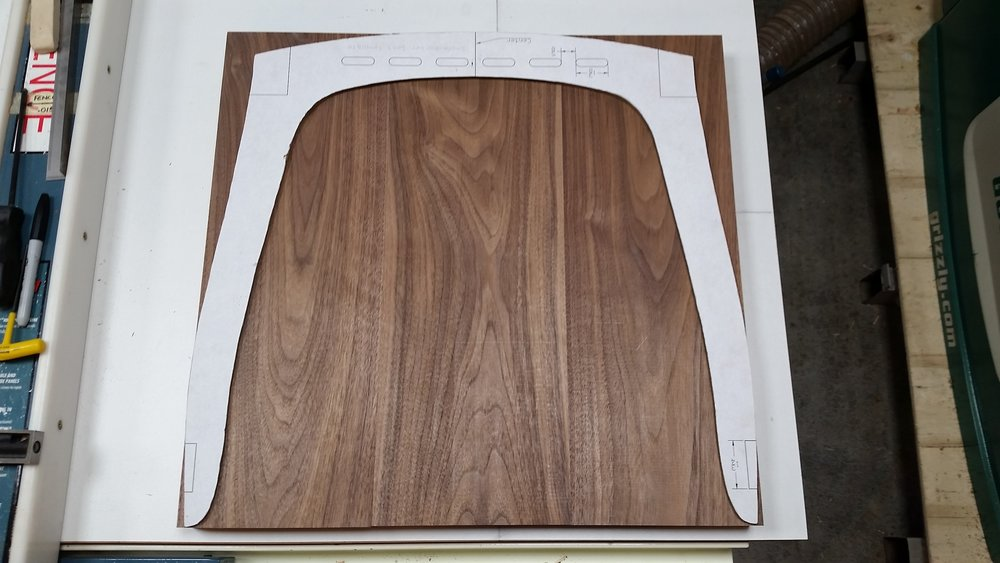 Seat boards cut to width and length with the seat template on top.