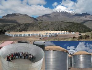 Representación de cómo se verá el observatorio el próximo año. En la esquina inferior izquierda se muestra a un grupo de investigadores dentro de los tanques de 4 metros de alto. (página oficial del HAWC y Nature).