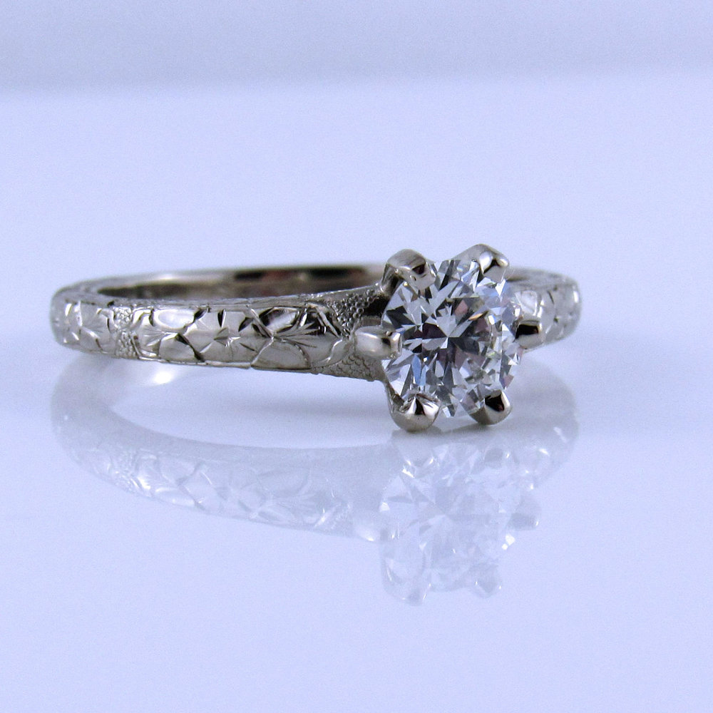 Tattoo Ring - This unique ring is detailed with engraving that matches the wearer of the ring. The ring has a Canadian diamond and is metal is 14 karat white palladium gold.#DiamondEngagement #CanadianDiamond