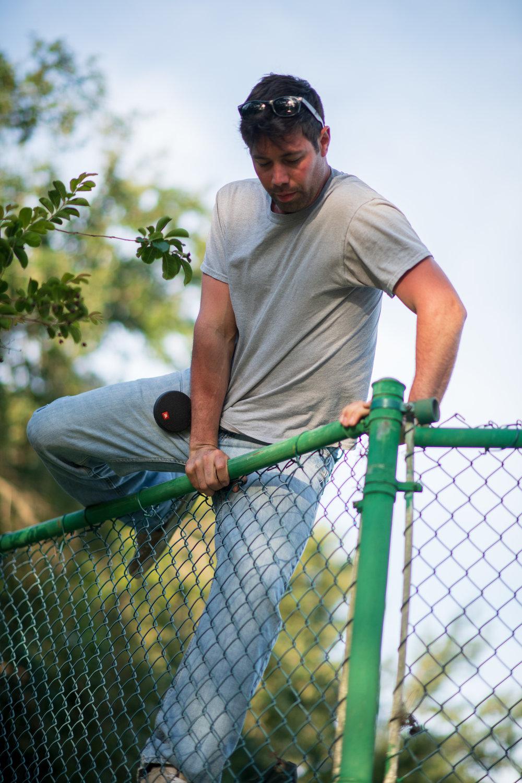 Jamie Climbing Tennis Court Fence.jpg