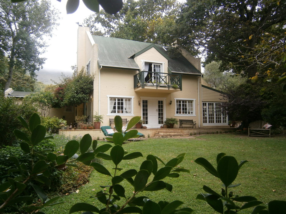 A Magical Forested Getaway - The house at Pooh Corner is situated on an acre plot in Noordhoek valley, nestled between the Indian and Atlantic Oceans. The peaceful setting & luxury accommodation promise to delight our guests.Pooh Corner will be enjoyed most by those who want to get away from the noise and crowds, to a beautiful home from home. Enjoy sumptuous breakfasts, served in the garden and watch the squirrels cavorting in the trees. 100 year old oak trees and the original nineteenth century Chapman's Peak Drive bridge,form wonderful accents in the forested garden. A Bonsai garden, a romantically secluded swimming pool and formal herb garden all add to the charm of staying at Pooh Corner.