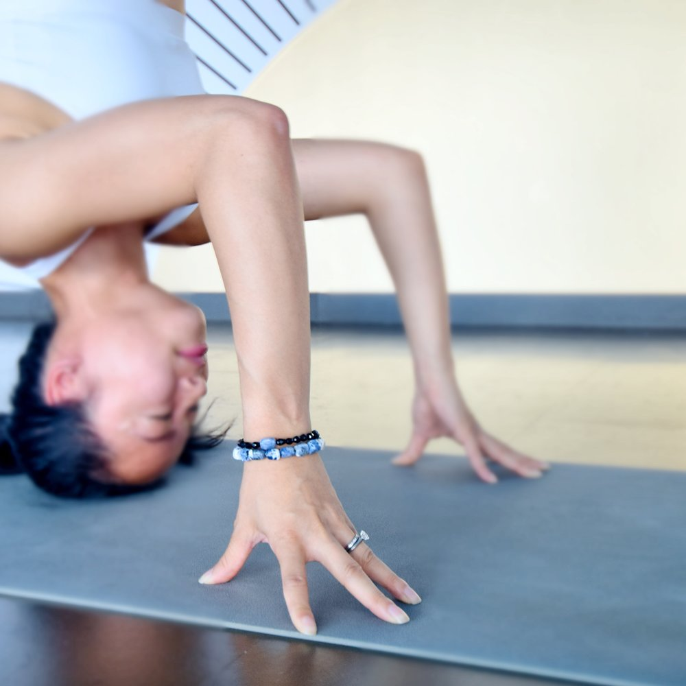 Headstand by Queenie, a Toronto, Canada yoga instructor.