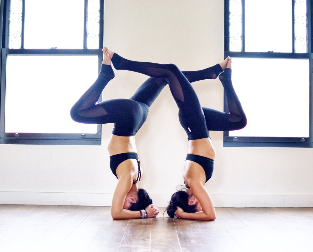 Su and Queenie doing partner yoga together in Toronto