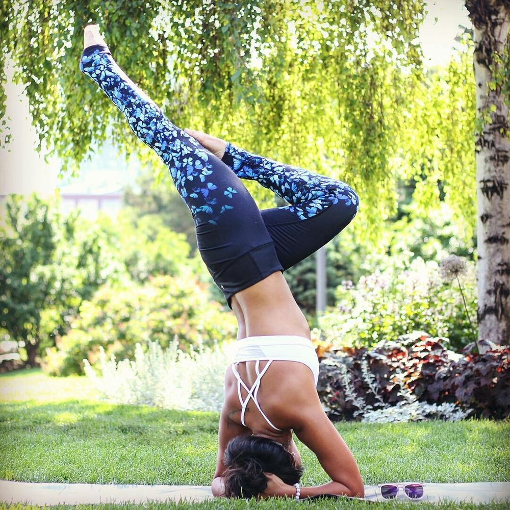 Su doing a headstand in white howlite yoga bracelet by Aura