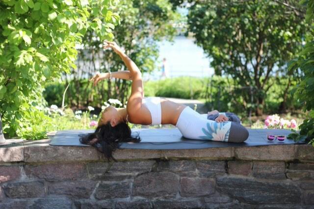 Toronto Yogi Su doing yoga poses in the park