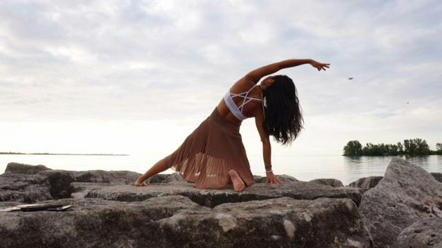 Toronto Yogi, Su, wearinga  white Howlite bracelet and doing yoga