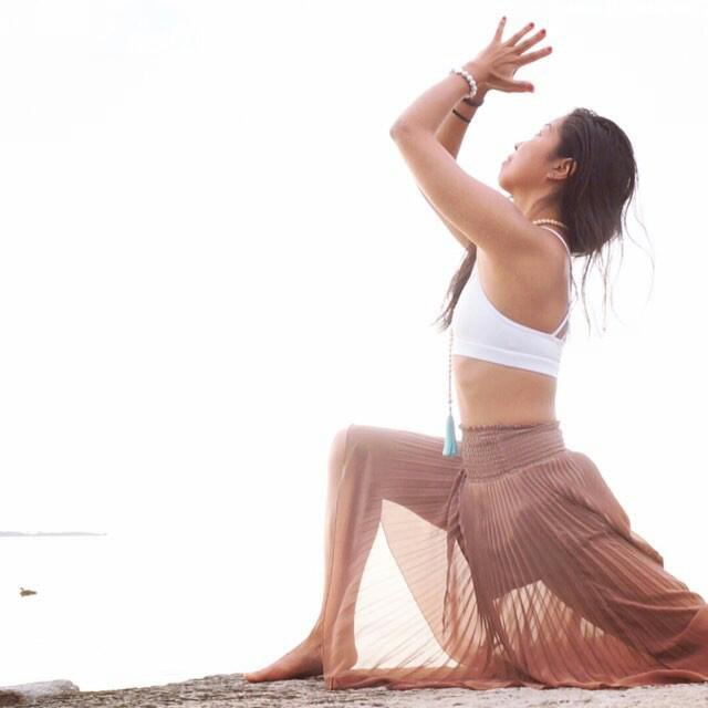 Su, Toronto Yogi, enjoying some summer yoga while wearing a white howlite yoga bracelet