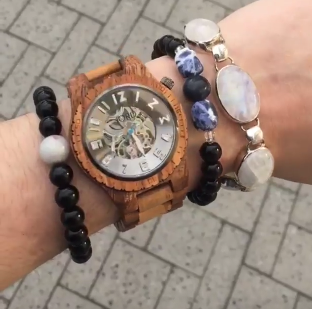stacking up gemstone bracelets with a watch