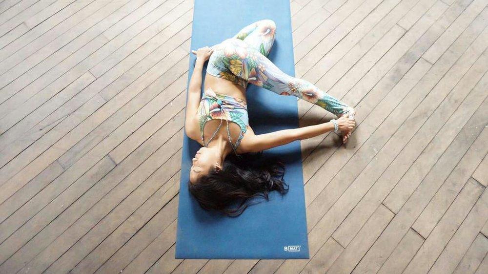 Su, Toronto Yogi, showing her flexibility. Wearing Aura gemstone bracelets