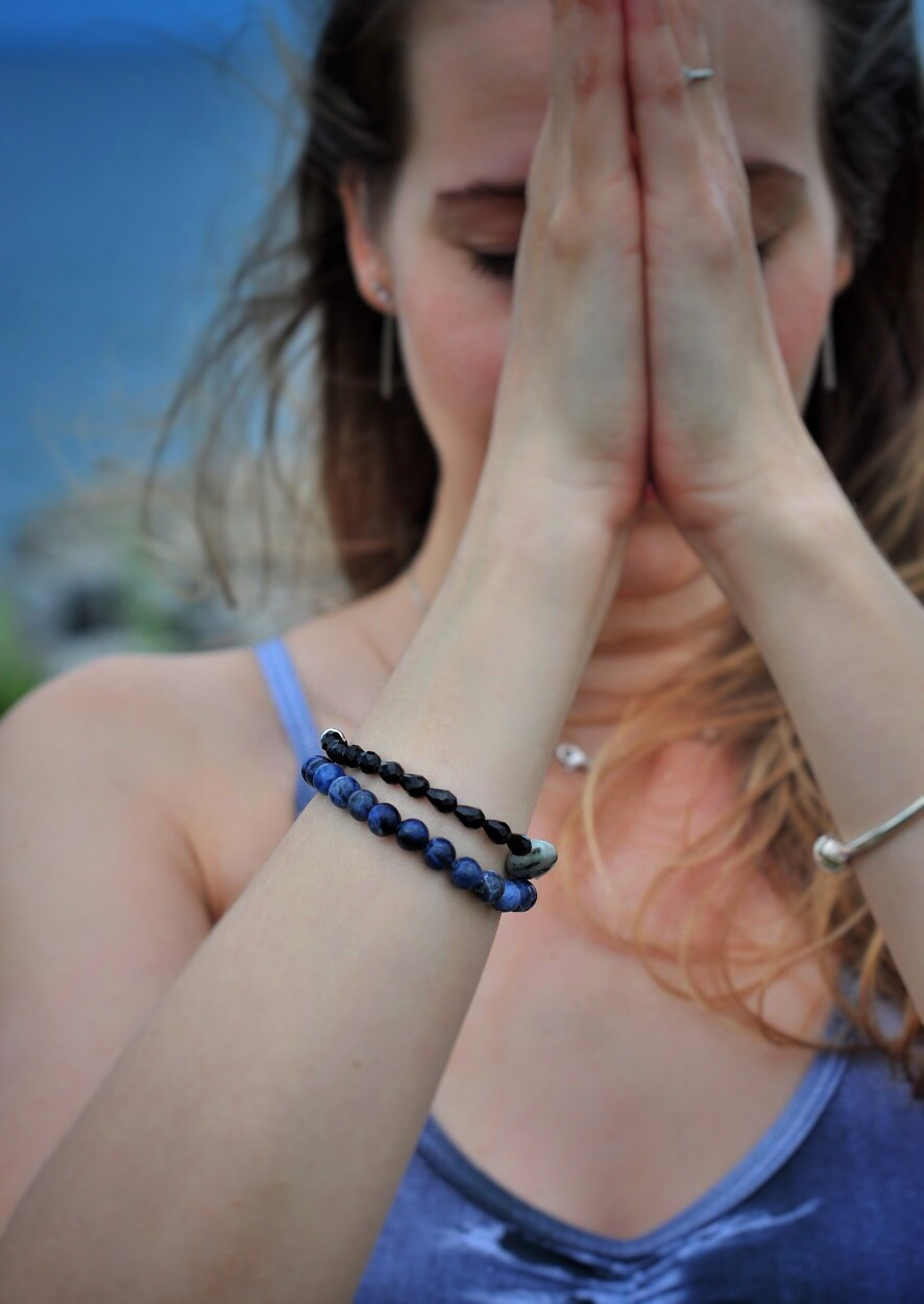 Darya feeling zen in two Aura yoga bracelets